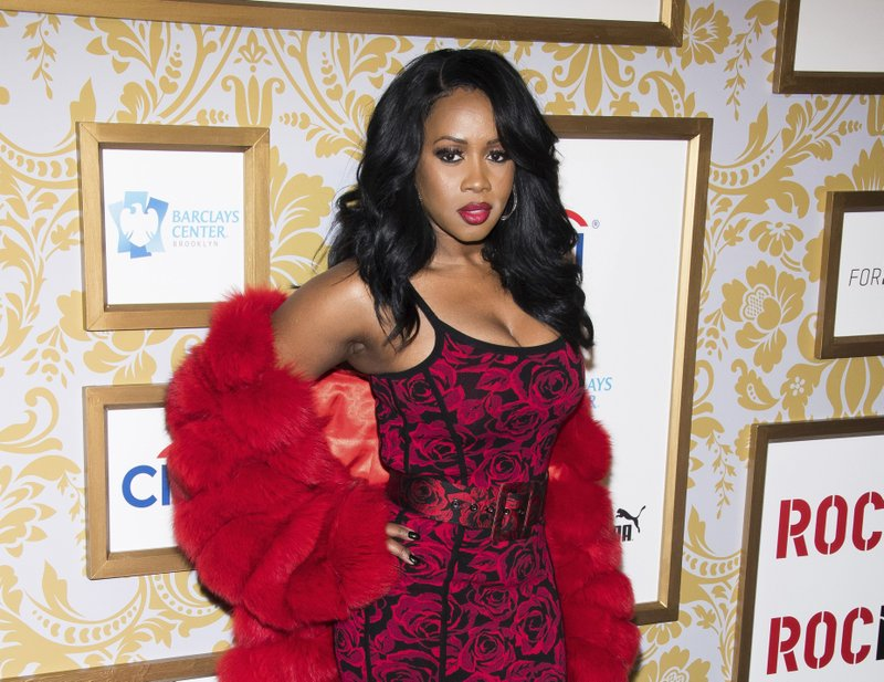 """FILE - This Jan. 27, 2018 file photo shows Remy Ma at the Roc Nation pre-Grammy brunch in New York. The rapper has been arrested on assault charges for allegedly attacking a reality television personality in New York last week. Police say the 38-year-old rapper, whose real name is Reminisce Smith, turned herself in on Wednesday. She's accused of punching her """"Love & Hip Hop New York"""" co-star Brittney Taylor in the face during an April 16 concert at Irving Plaza in Manhattan. (Photo by Charles Sykes/Invision/AP, File)"""