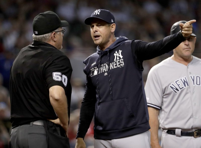 New York Yankees manager Aaron Boone argues with umpire Paul Emmel after being ejected during the seventh inning of a baseball game against the Arizona Diamondbacks, Wednesday, May 1, 2019, in Phoenix. (AP Photo/Matt York)