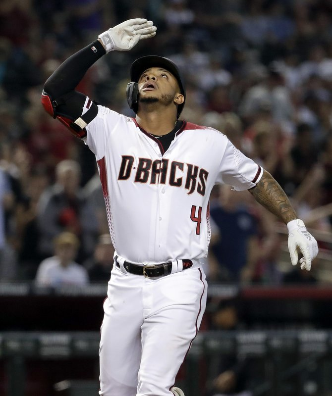 Arizona Diamondbacks' Ketel Marte salutes after hitting a solo home run against the New York Yankees during the fourth inning of a baseball game, Wednesday, May 1, 2019, in Phoenix. (AP Photo/Matt York)