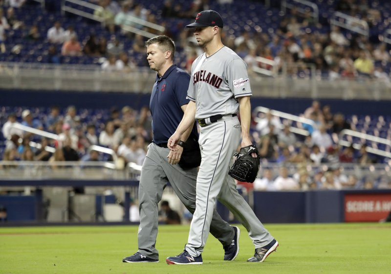 Cleveland Indians starting pitcher Corey Kluber, right, leaves during the fifth inning of the team's baseball game against the Miami Marlins, Wednesday, May 1, 2019, in Miami. Kluber was hit by a single hit by Marlins' Brian Anderson. (AP Photo/Lynne Sladky)