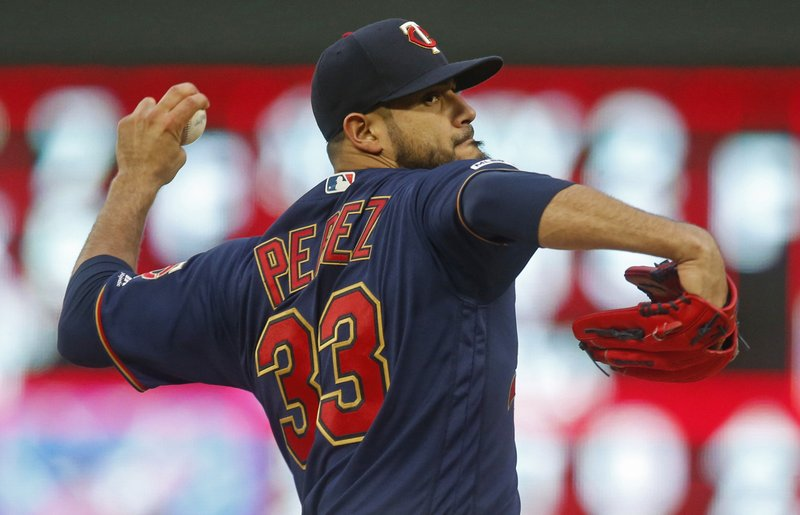 Minnesota Twins' pitcher Martin Perez throws against the Houston Astros in the first inning of a baseball game Wednesday, May 1, 2019, in Minneapolis. (AP Photo/Jim Mone)