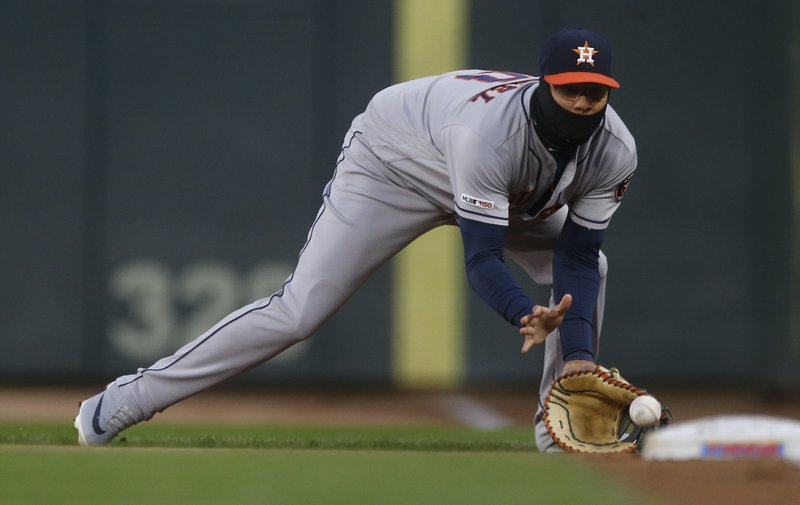 Houston Astros first baseman Yuli Gurriel fields a grounder as Minnesota Twins' Jorge Polanco lined out to him in the first inning of a baseball game Wednesday, May 1, 2019, in Minneapolis. (AP Photo/Jim Mone)