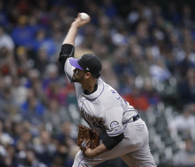 Colorado Rockies starting pitcher Antonio Senzatela throws to a Milwaukee Brewers batter during the first inning of a baseball game Wednesday, May 1, 2019, in Milwaukee. (AP Photo/Jeffrey Phelps)