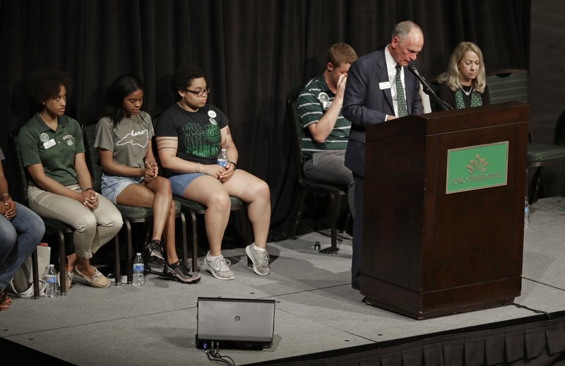 UNC Charlotte Chancellor Philip Dubois pauses as he speaks to students during a vigil at the University of North Carolina-Charlotte in Charlotte, N.C., Wednesday, May 1, 2019 after a student with a pistol killed two people and wounded four others on Tuesday. (AP Photo/Chuck Burton)