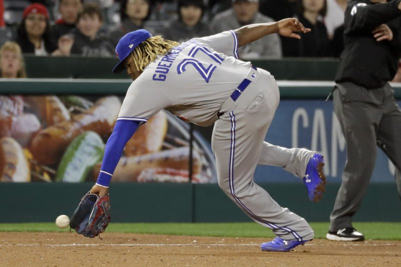 Toronto Blue Jays third baseman Vladimir Guerrero Jr. fields a ball hit by Los Angeles Angels' David Fletcher during the seventh inning of a baseball game in Anaheim, Calif., Wednesday, May 1, 2019. Fletcher was out at first. (AP Photo/Chris Carlson)