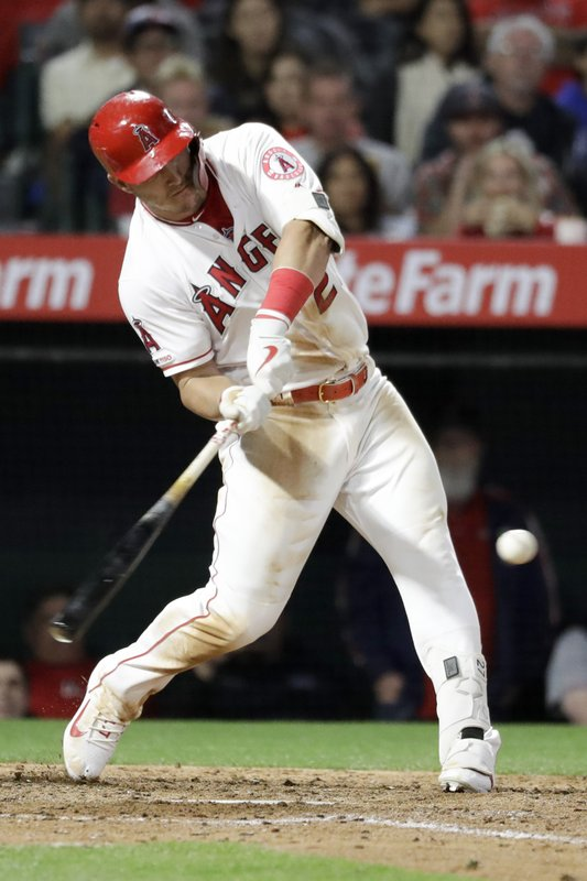 Los Angeles Angels' Mike Trout hits a three-run double against the Toronto Blue Jays during the fourth inning of a baseball game in Anaheim, Calif., Wednesday, May 1, 2019. (AP Photo/Chris Carlson)