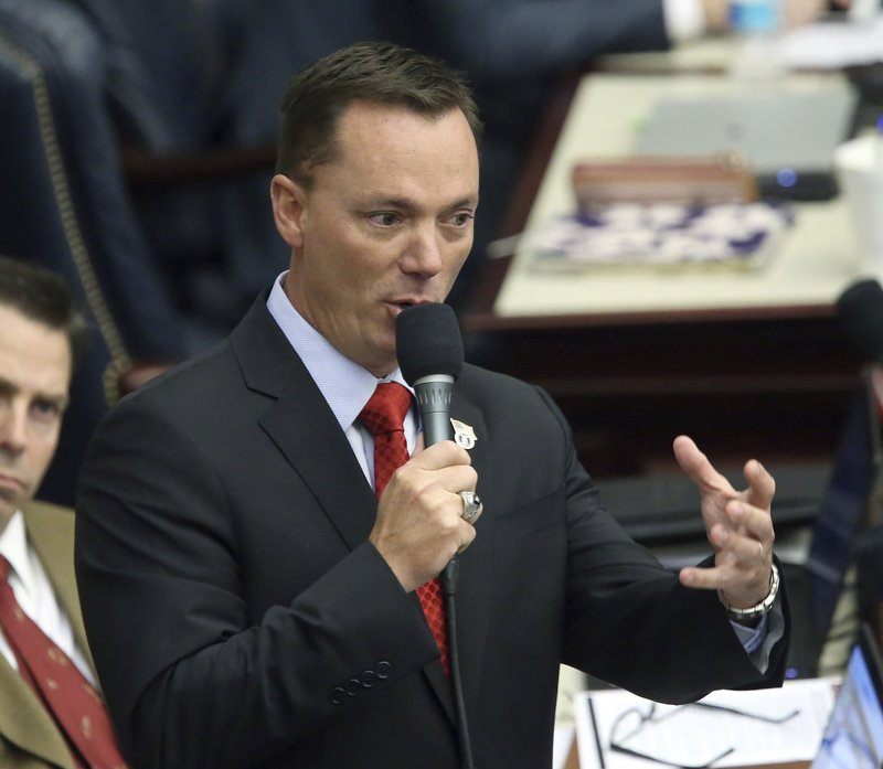 Rep. Tommy Gregory, R-Sarasota, debates on a bill to allow teachers to be armed during session Wednesday May 1, 2019, in Tallahassee, Fla. (AP Photo/Steve Cannon)
