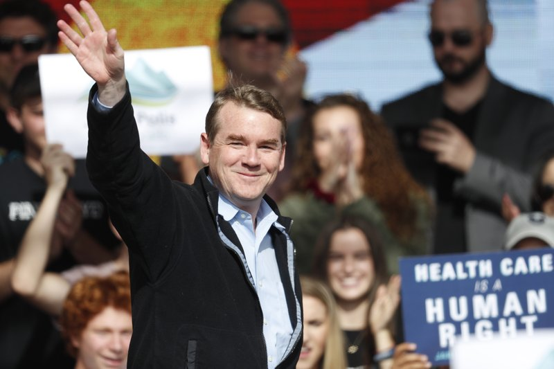"""FILE - In this Oct. 24, 2018, file photo, U.S. Senator Michael Bennet, D-Colo., greets voters during a rally with young voters on the campus of the University of Colorado in Boulder, Colo. Bennet says he is seeking the Democratic nomination for president in 2020. The three-term senator made the announcement Thursday on """"CBS This Morning."""" He is now among more than 20 Democrats seeking the party's presidential nomination. (AP Photo/David Zalubowski, File)"""