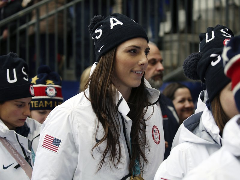 FILE - In this March 4, 2018, file photo, Hilary Knight, of the gold medal winning U.S. women's Olympic hockey team, attends a SheBelieves Cup women's soccer match between the United States and France, in Harrison, N.J. More than 200 of the top female hockey players in the world have decided they will not play professionally in North America next season, hoping their stand leads to a single economically sustainable league. The announcement Thursday, May 2, 2019, comes after the Canadian Women's Hockey League abruptly shut down as of Wednesday, leaving the five-team, U.S.-based National Women's Hockey League as the only pro league in North America. The group of players, led by American stars Hilary Knight and Kendall Coyne Schofield and Canadian goaltender Shannon Szabados, hopes their move eventually pushes the NHL to start its own women's hockey league as the NBA did with the WNBA. (AP Photo/Steve Luciano, File)