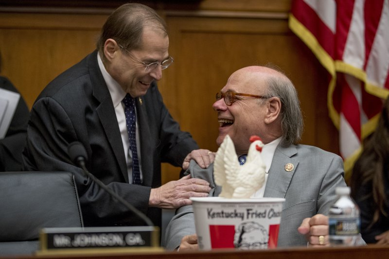 Judiciary Committee Chairman Jerrold Nadler, D-N.Y., left, laughs with Rep. Steve Cohen, D-Tenn., right, after Cohen arrived with a bucked of fried chicken and a prop chicken as Attorney General William Barr will not appear before a House Judiciary Committee hearing on Capitol Hill in Washington, Thursday, May 2, 2019. The House Judiciary Committee witness chair will be without its witness this morning, Attorney General William Barr, who informed the Democrat-controlled panel he will skip a scheduled hearing on special counsel Robert Mueller's report, escalating an already acrimonious battle between Democrats and the Justice Department. (AP Photo/Andrew Harnik)