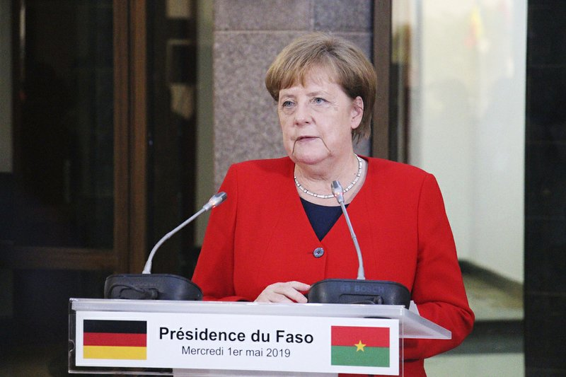 German Chancellor Angela Merkel speaks during a news conference with Burkina Faso President Roch Marc Christian Kabore at the Presidential Palace in Ouagadougou, Burkina Faso, Wednesday, May 1, 2019. Merkel has arrived in the West African nation of Burkina Faso. Merkel is on a three-nation tour in the region. (AP Photo/Alain Didier Compaore)