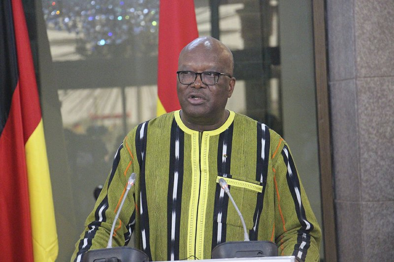 Burkina Faso President Roch Marc Christian Kabore speaks during a news conference with German Chancellor Angela Merkel at the Presidential Palace in Ouagadougou, Burkina Faso, Wednesday, May 1, 2019. Merkel has arrived in the West African nation of Burkina Faso. Merkel is on a three-nation tour in the region. (AP Photo/Alain Didier Compaore)