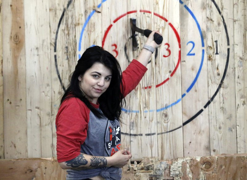 General manager Devan Watanabe poses for a photo at Social Axe Throwing Wednesday, May 1, 2019, in Salt Lake City. The Utah Department of Alcoholic Beverage Control announced Tuesday, April 30, 2019, that beer will not be allowed at a Salt Lake City karaoke business or an Ogden ax-throwing venue because neither fits the 14 definitions of a