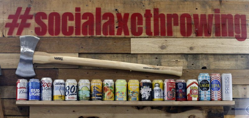 Beers are shown on the wall of Social Axe Throwing Wednesday, May 1, 2019, in Salt Lake City. The Utah Department of Alcoholic Beverage Control announced Tuesday, April 30, 2019, that beer will not be allowed at a Salt Lake City karaoke business or an Ogden ax-throwing venue because neither fits the 14 definitions of a