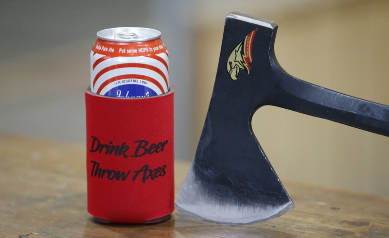 A beer is shown at Social Axe Throwing Wednesday, May 1, 2019, in Salt Lake City. The Utah Department of Alcoholic Beverage Control announced Tuesday, April 30, 2019, that beer will not be allowed at a Salt Lake City karaoke business or an Ogden ax-throwing venue because neither fits the 14 definitions of a