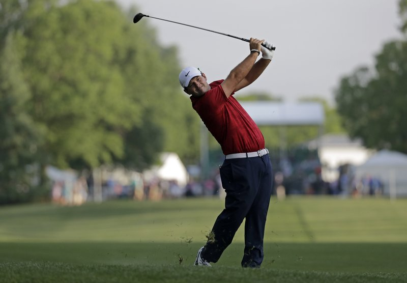 Patrick Reed hits from the 10th fairway during the first round of the Wells Fargo Championship golf tournament at Quail Hollow Club in Charlotte, N.C., Thursday, May 2, 2019. (AP Photo/Chuck Burton)