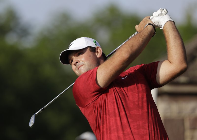 Patrick Reed watches his tee shot on the 13th hole during the first round of the Wells Fargo Championship golf tournament at Quail Hollow Club in Charlotte, N.C., Thursday, May 2, 2019. (AP Photo/Chuck Burton)