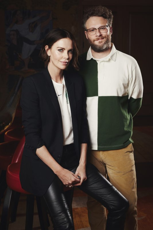 This April 29, 2019 photo shows co-stars Charlize Theron, left, and Seth Rogen posing for a portrait in New York to promote their film