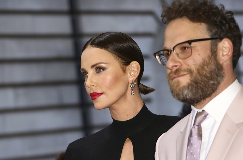 Actors Charlize Theron, left, and Seth Rogan pose for photographers at the premiere of the film 'Long Shot' in London, Thursday, April 25, 2019. (Photo by Joel C Ryan/Invision/AP)