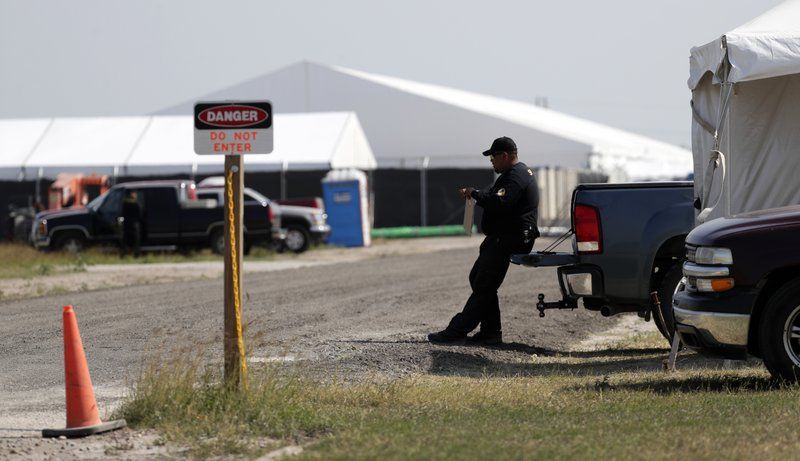 In this Wednesday, May 1, 2019, photo, a U.S. Customs and Border Protection temporary facility is prepared near the Donna International Bridge, in Donna, Texas. Officials say the site will primarily be used as a temporary site for processing and care of unaccompanied migrant children and families. (AP Photo/Eric Gay)