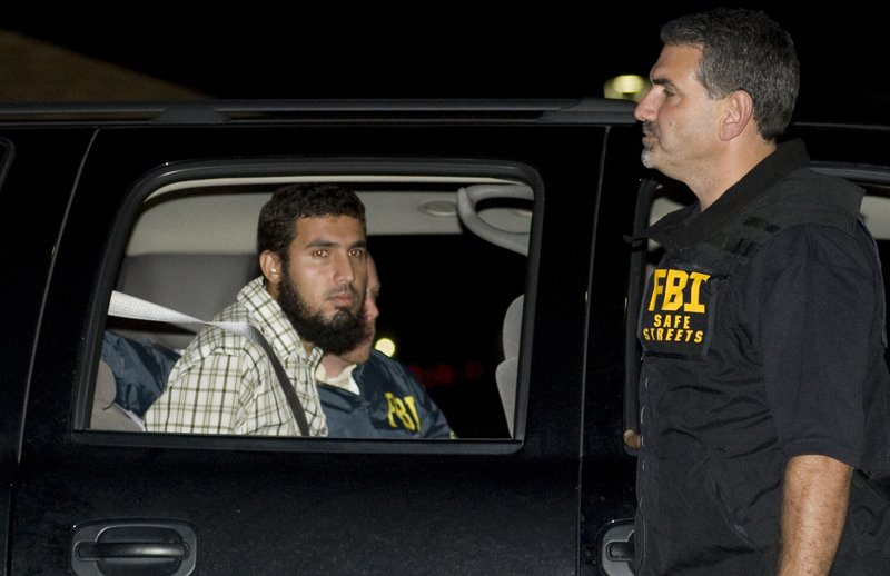 FILE - In this Sept. 19, 2009 file photo, terrorism suspect Najibullah Zazi is seated in an FBI vehicle after being arrested by the FBI in Aurora, Colo. Zazi, who plotted to bomb New York City's subways, and then switched sides after his arrest and spent nearly a decade helping the U.S. identify and prosecute terrorists, was rewarded for his help Thursday, May 2, 2019 with a sentence of 10 years in prison, effectively time he has already served. (Chris Schneider/The Denver Post via AP, File)
