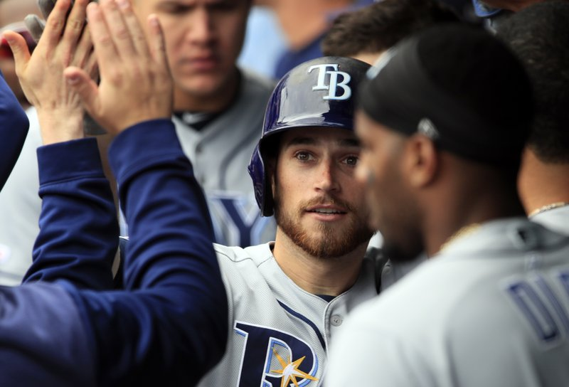 Tampa Bay Rays' Brandon Lowe is congratulated by teammates after hitting a two-run home run during the ninth inning of a baseball game against the Kansas City Royals at Kauffman Stadium in Kansas City, Mo., Thursday, May 2, 2019. The Rays defeated the Royals 3-1. (AP Photo/Orlin Wagner)