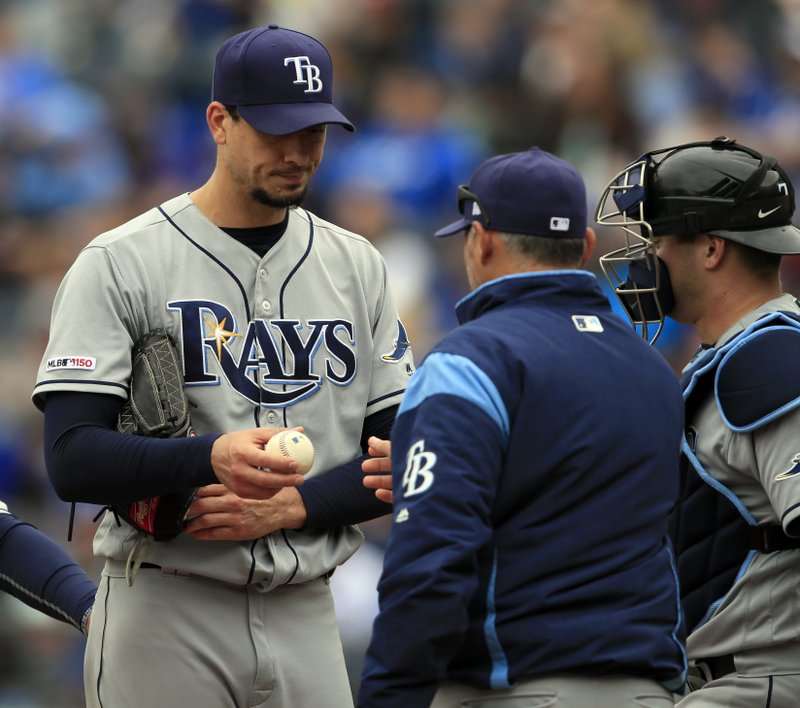 Tampa Bay Rays starting pitcher Charlie Morton, left, hands the ball to manager Kevin Cash during the seventh inning of a baseball game against the Kansas City Royals at Kauffman Stadium in Kansas City, Mo., Thursday, May 2, 2019. The Rays defeated the Royals 3-1. (AP Photo/Orlin Wagner)