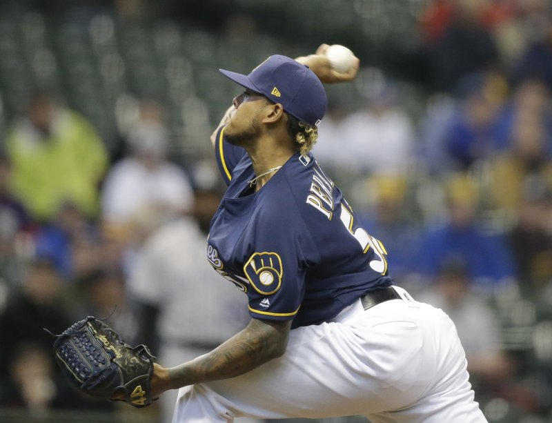 Milwaukee Brewers starting pitcher Freddie Peralta throws to the Colorado Rockies during the first inning of a baseball game Thursday, May 2, 2019, in Milwaukee. (AP Photo/Jeffrey Phelps)