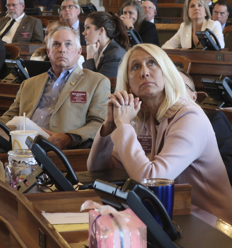 Kansas state Reps. Don Hineman, R-Dighton, left, and Renee Erickson, R-Wichita, watch an electronic vote-tallying board as the House fails to revive an anti-abortion bill vetoed by Democratic Gov. Laura Kelly, Thursday, May 2, 2019, at the Statehouse in Topeka, Kansas. Both Hineman and Erickson support the measure, which would require abortion providers to tell patients that a medication abortion can reversed once it has been started. (AP Photo/John Hanna)