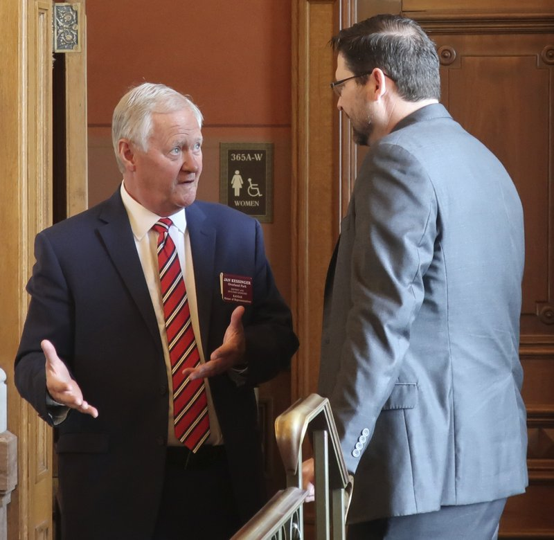 Kansas state Rep. Jan Kessinger, left, R-Overland Park, talks with House Speaker Ron Ryckman Jr., R-Olathe, before an unsuccessful attempt to revive an anti-abortion bill vetoed by Democratic Gov. Laura Kelly, Thursday, May 2, 2019, at the Statehouse in Topeka, Kansas. Kessinger was the only Republican to vote against saving the bill. (AP Photo/John Hanna)
