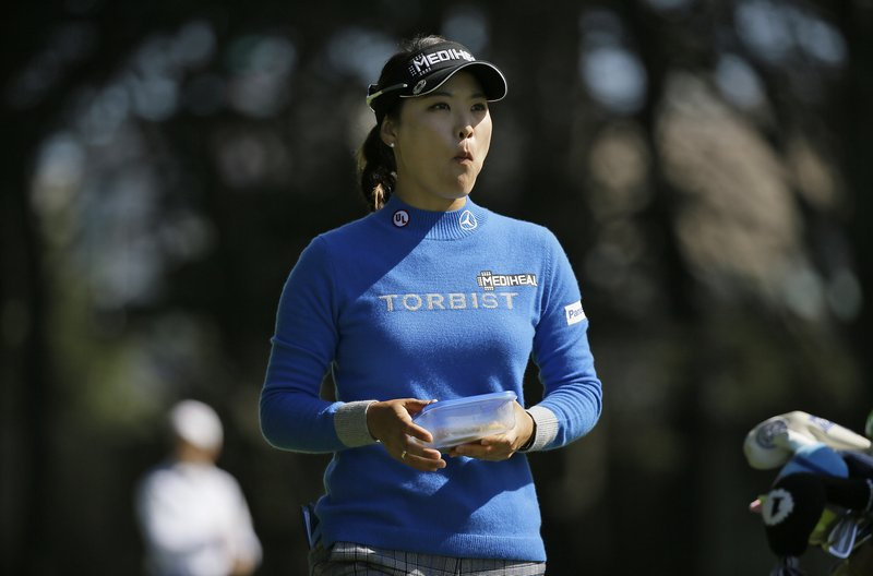 So Yeon Ryu, of South Korea, walks down the 18th fairway of the Lake Merced Golf Club during the first round of the LPGA Mediheal Championship golf tournament Thursday, May 2, 2019, in Daly City, Calif. (AP Photo/Eric Risberg)