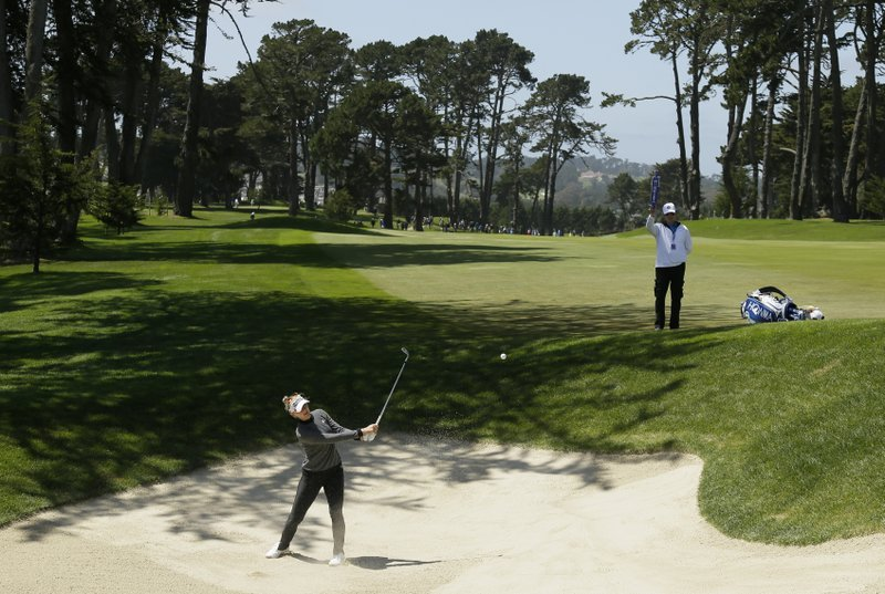Brooke Henderson, of Canada, hits the ball out of a bunker up to the fifth green of the Lake Merced Golf Club during the first round of the LPGA Mediheal Championship golf tournament Thursday, May 2, 2019, in Daly City, Calif. (AP Photo/Eric Risberg)