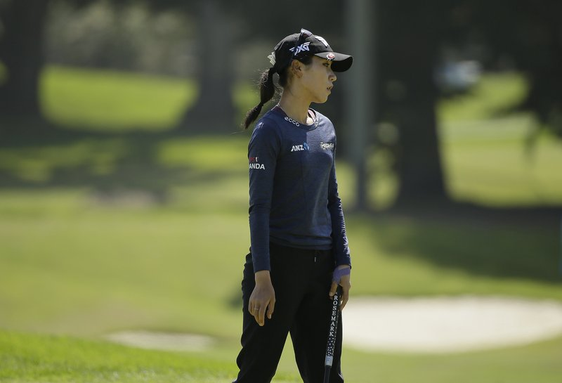 Lydia Ko, of New Zealand, reacts after missing a birdie putt on the ninth green of the Lake Merced Golf Club during the first round of the LPGA Mediheal Championship golf tournament Thursday, May 2, 2019, in Daly City, Calif. (AP Photo/Eric Risberg)