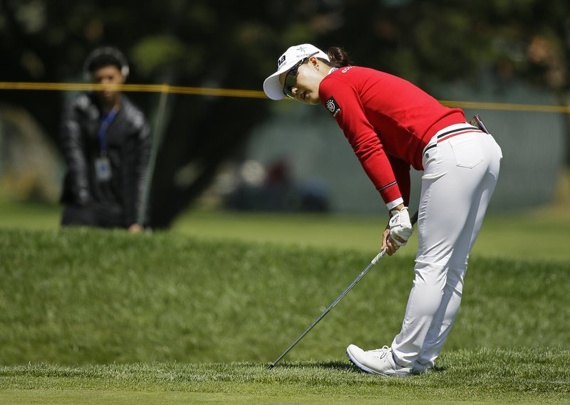 Minjee Lee, of Australia, reacts after chipping the ball close to the pin on the fifth green of the Lake Merced Golf Club during the first round of the LPGA Mediheal Championship golf tournament Thursday, May 2, 2019, in Daly City, Calif. (AP Photo/Eric Risberg)