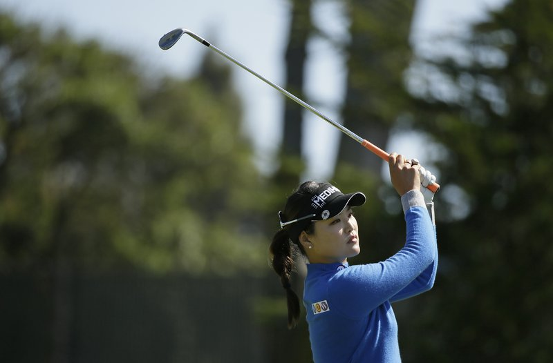 So Yeon Ryu, of South Korea, follows her approach shot to the 18th green of the Lake Merced Golf Club during the first round of the LPGA Mediheal Championship golf tournament Thursday, May 2, 2019, in Daly City, Calif. (AP Photo/Eric Risberg)