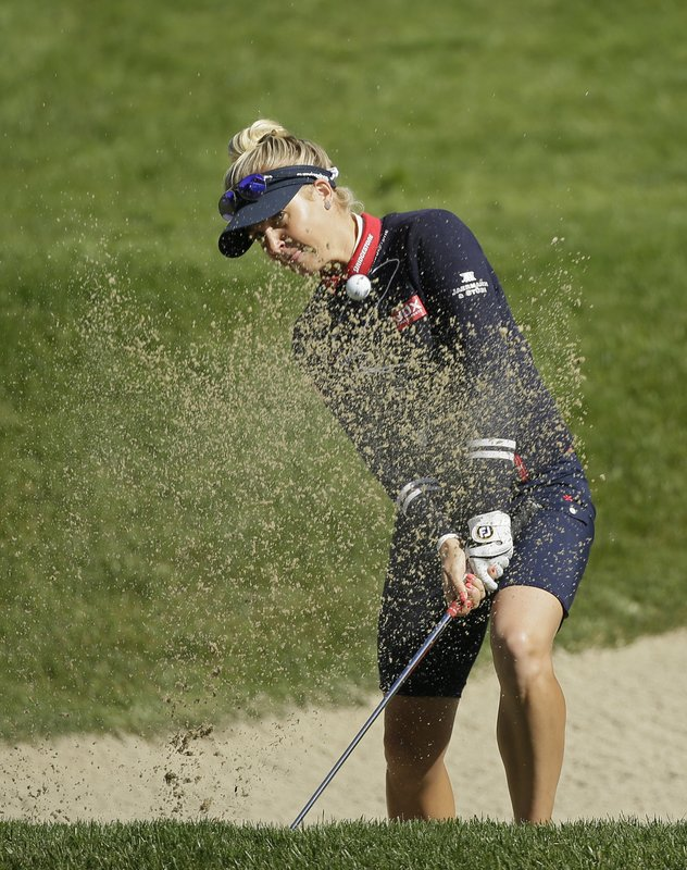 Charley Hull, of England, follows her shot out of a bunker up to the 18th green of the Lake Merced Golf Club during the first round of the LPGA Mediheal Championship golf tournament Thursday, May 2, 2019, in Daly City, Calif. (AP Photo/Eric Risberg)