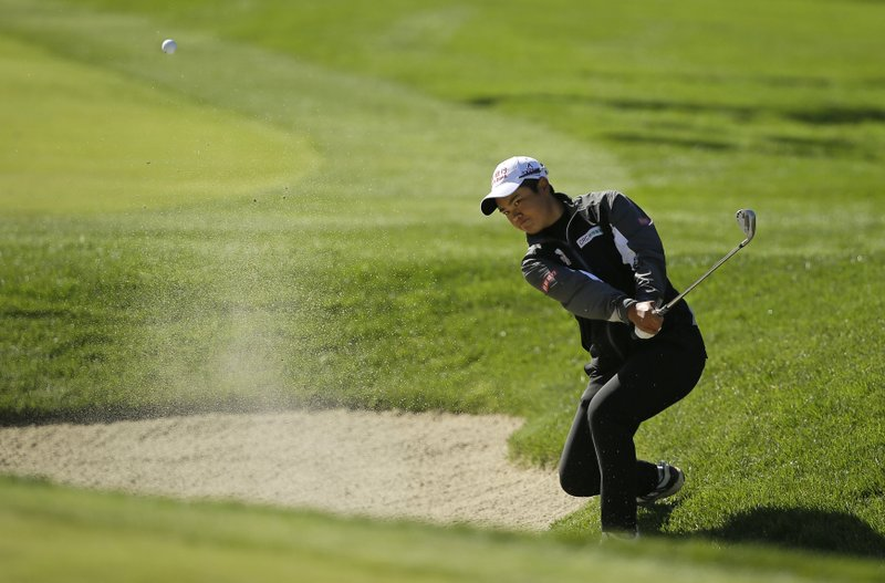 Peiyun Chien, of Taiwan, follows her shot out of a bunker up to the 10th green of the Lake Merced Golf Club during the first round of the LPGA Mediheal Championship golf tournament Thursday, May 2, 2019, in Daly City, Calif. (AP Photo/Eric Risberg)
