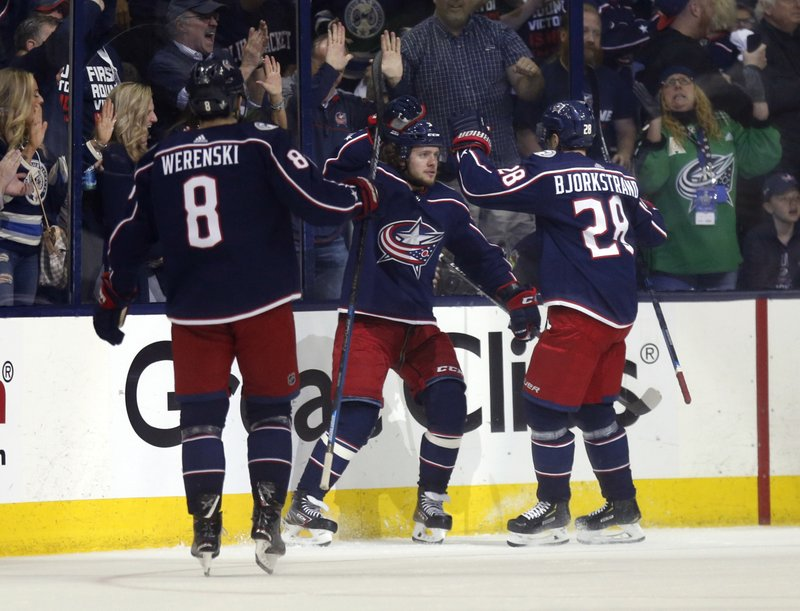 Columbus Blue Jackets forward Artemi Panarin, center, of Russia, celebrates his goal against the Boston Bruins with defenseman Zach Werenski, left, and forward Oliver Bjorkstrand, of Denmark, during the first period of Game 4 of an NHL hockey second-round playoff series in Columbus, Ohio, Thursday, May 2, 2019. (AP Photo/Paul Vernon)
