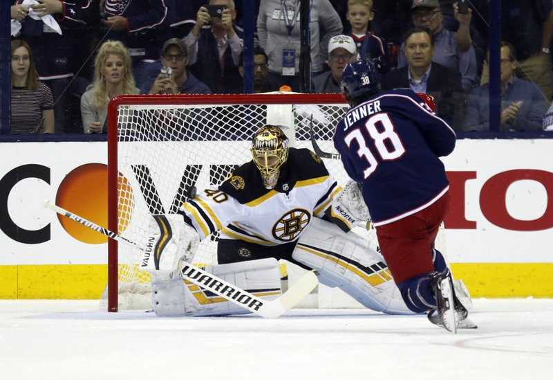 Boston Bruins goalie Tuukka Rask, left, of Finland, stops a penalty shot by Columbus Blue Jackets forward Boone Jenner during the first period of Game 4 of an NHL hockey second-round playoff series in Columbus, Ohio, Thursday, May 2, 2019. (AP Photo/Paul Vernon)