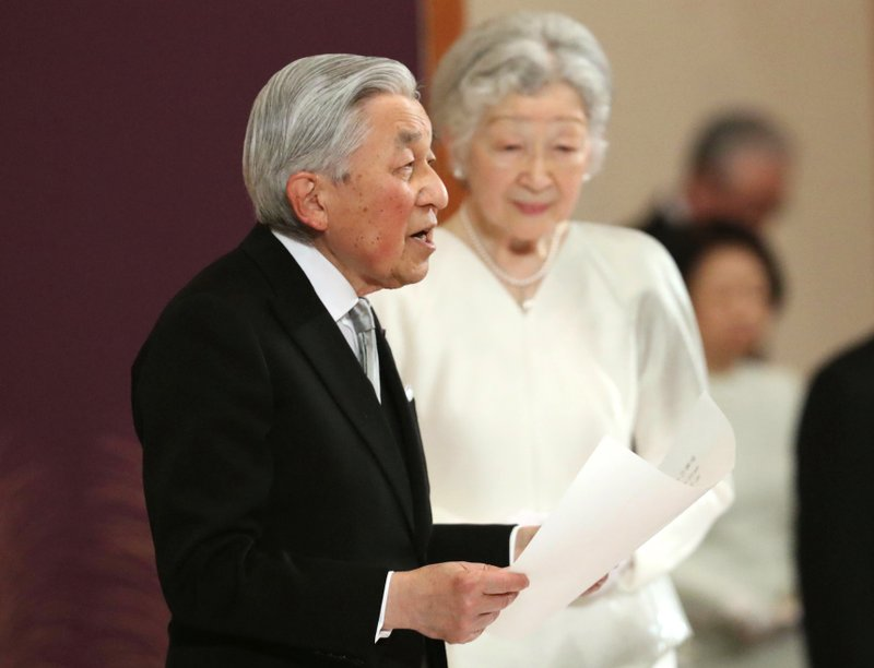 In this April 30, 2019, photo, Japan's Emperor Akihito, accompanied by Empress Michiko, speaks during the ceremony of his abdication in front of other members of the royal families and top government officials at the Imperial Palace in Tokyo. The 85-year-old Akihito ends his three-decade reign on Tuesday as his son Crown Prince Naruhito will ascend the Chrysanthemum throne on Wednesday. (Japan Pool via AP)
