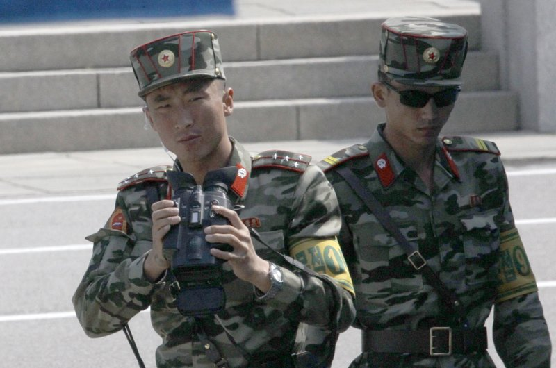 In this May 1, 2019, photo, North Korean soldiers look at the South side, seen during a press tour at the border village of Panmunjom in the Demilitarized Zone, South Korea. South Korea on Wednesday resumed the southern side of Panmunjom tour to tourists. (AP Photo/Lee Jin-man)