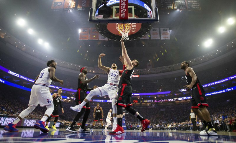 Philadelphia 76ers' Ben Simmons, center left, of Australia, shoots against Toronto Raptors' Marc Gasol, center right, of Spain, during the first half of Game 3 of a second-round NBA basketball playoff series Thursday, May 2, 2019, in Philadelphia. (AP Photo/Chris Szagola)