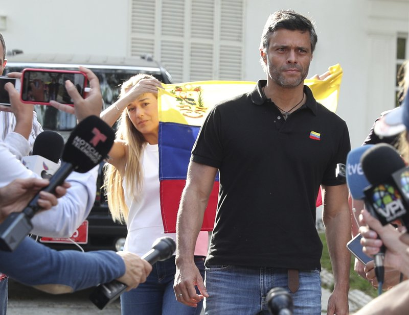 Venezuelan opposition leader Leopoldo Lopez walks to gate of the Spanish ambassador's residence in Caracas to speak with the press, in Venezuela, Thursday, May 2, 2019. López said he expects that the country's military will step up to overthrow President Nicolas Maduro despite setbacks. (AP Photo/Martin Mejia)