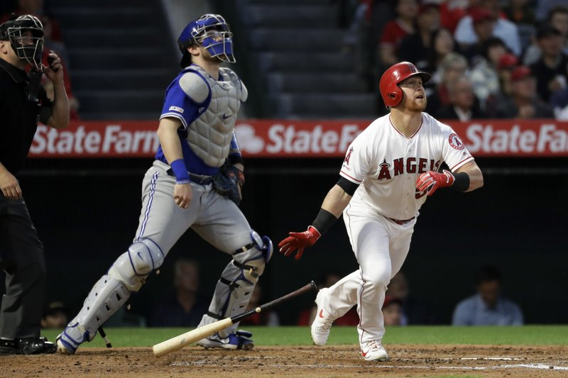 Los Angeles Angels' Kole Calhoun watches his two-run home run against the Toronto Blue Jays during the second inning of a baseball game in Anaheim, Calif., Thursday, May 2, 2019. (AP Photo/Chris Carlson)
