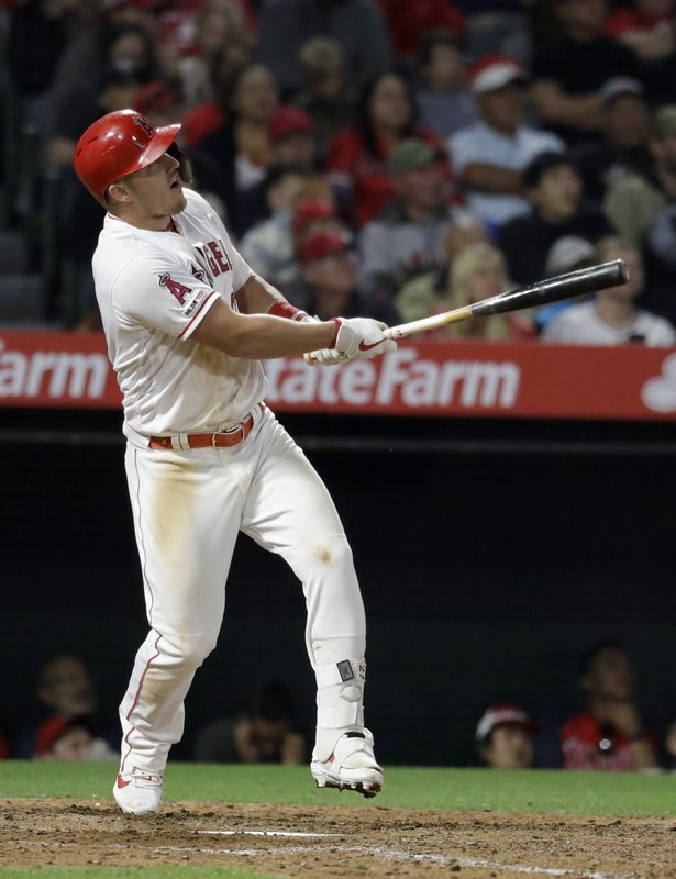 Los Angeles Angels' Mike Trout watches his home run against the Toronto Blue Jays during the sixth inning of a baseball game in Anaheim, Calif., Thursday, May 2, 2019. (AP Photo/Chris Carlson)