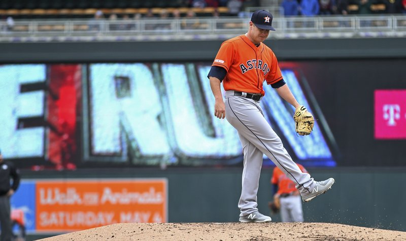 Minnesota Twins' Jason Castro runs the bases on a solo home run off Houston Astros pitcher Brad Peacock in the third inning of a baseball game Thursday, May 2, 2019, in Minneapolis. (AP Photo/Jim Mone)