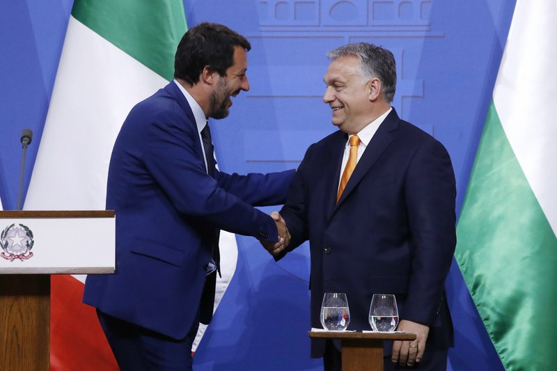 Italian Deputy Prime Minister and Minister of Interior Matteo Salvini, left, and Hungarian Prime Minister Viktor Orban shake hands during a joint press conference in the prime minister's office in Budapest, Hungary, Thursday, May 2, 2019. (Szilard Koszticsak/MTI via AP)