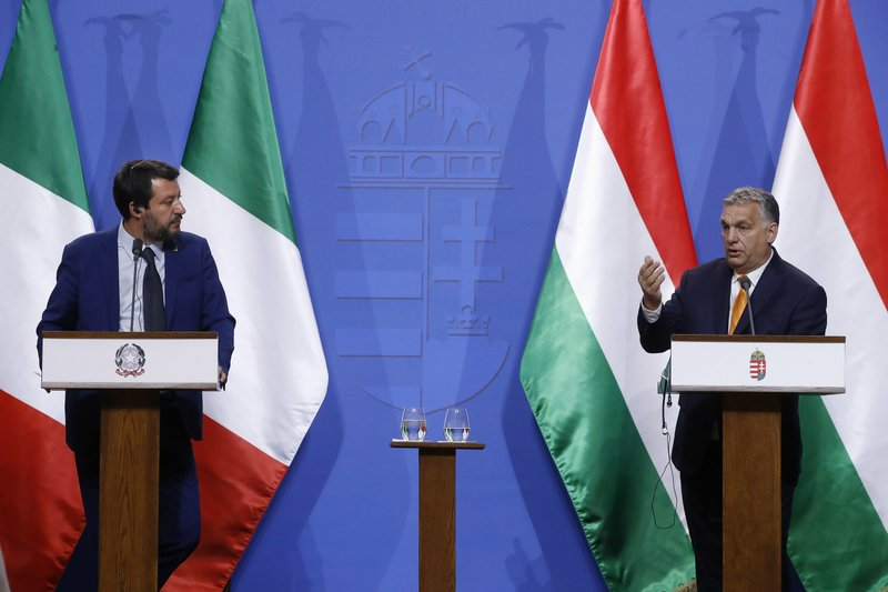 Italian Deputy Prime Minister and Minister of Interior Matteo Salvini, left, listens to Hungarian Prime Minister Viktor Orban during their joint press conference in the PM's office in Budapest, Hungary, Thursday, May 2, 2019. (Szilard Koszticsak/MTI via AP)