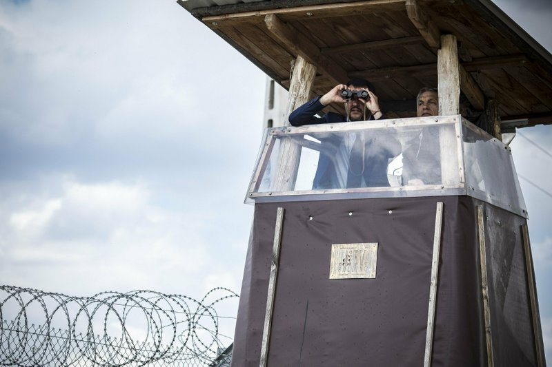 In this handout photo provided by the Hungarian Prime Minister's Press Office shows Hungarian Prime Minister Viktor Orban, right, and Italian Interior Minister Matteo Salvini observe the border from a watchtower during their visit at the Hungarian-Serbian border near Roszke, 180 kms southeast of Budapest, Hungary, Thursday, May 2, 2019. (Balazs Szecsodi/Hungarian Prime Minister's Press Office/MTI via AP)