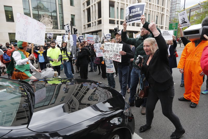 Assange supporters block a major roadway in front of Westminster Magistrates Court in London, Thursday, May 2, 2019.  WikiLeaks founder Julian Assange is facing court over a U.S. request to extradite him for alleged computer hacking.(AP Photo/Frank Augstein)